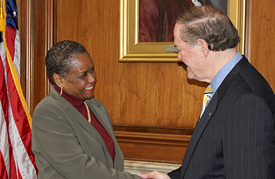 Davita Vance-Cooks, Acting Public Printer and first woman to lead GPO, exchanges a handshake with departing Public Printer Bill Boarman.